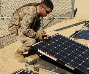 Marines work on solar panels in California in 2012.