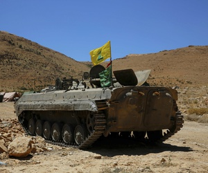 A Hezbollah armored vehicle sits at the site where clashes erupted between Hezbollah and al-Qaida-linked fighters in Wadi al-Kheil or al-Kheil Valley in the Lebanon-Syria border.