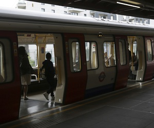 Passengers board a train at Parsons Green subway station after it was reopened following a terrorist attack on a train at the station yesterday in London, Saturday Sept. 16, 2017.