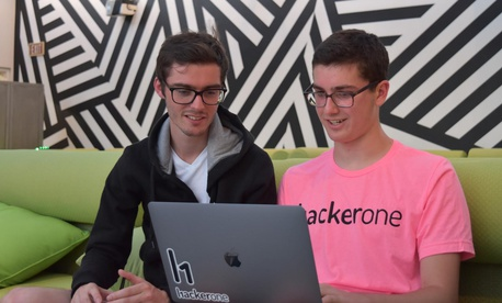 Jack Cable, right, with HackerOne co-founder Jobert Abma in July.