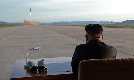 Kim Jong Un watches the launch of a Hwasong-12 missile in this undated photo released by North Korea's Korean Central News Agency (KCNA) on September 16, 2017.
