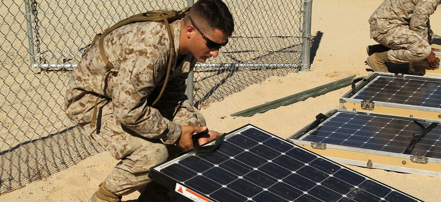 Marines work on solar panels in California in 2012.