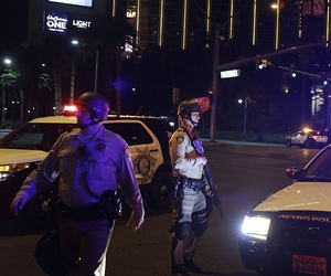 Police officers stand along the Las Vegas Strip outside the Mandalay Bay resort and casino during a deadly shooting near the casino, Sunday, Oct. 1, 2017, in Las Vegas.