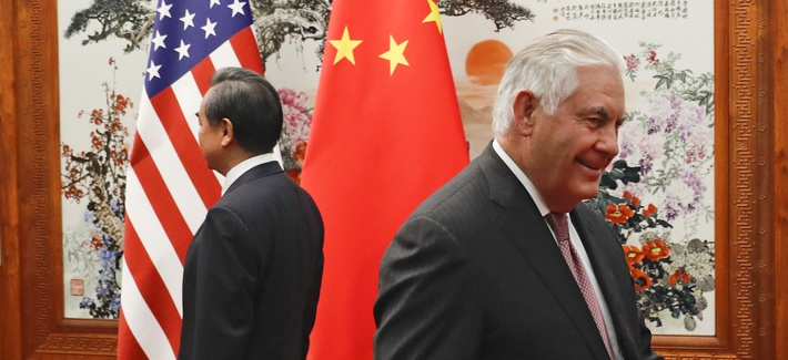 U.S. Secretary of State Rex Tillerson, right, walks by Chinese Foreign Minister Wang Yi before a meeting at the Great Hall of the People in Beijing, Saturday, Sept. 30, 2017.