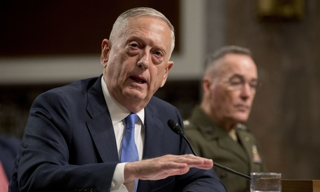 U.S. Defense Secretary Jim Mattis, left, accompanied by Joint Chiefs Chairman Gen. Joseph Dunford, speaks on Afghanistan before the Senate Armed Services Committee on Capitol Hill in Washington on Oct. 3, 2017.