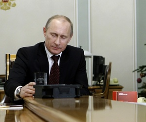 n this Tuesday, Dec. 28, 2010 file photo then Russian Prime Minister Vladimir Putin, left, holds a computer chip and a cell phone programmed to receive signals from Glonass.
