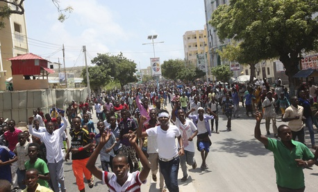 Angry protesters march near the scene of Saturday's massive truck bomb attack in which over 300 people were killed in Mogadishu, Somalia, Wednesday, Oct. 18, 2017.