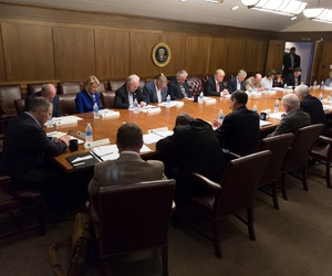 President Donald J. Trump, Vice President Mike Pence, and members of the Cabinet pray prior to their Cabinet meeting in Sept.