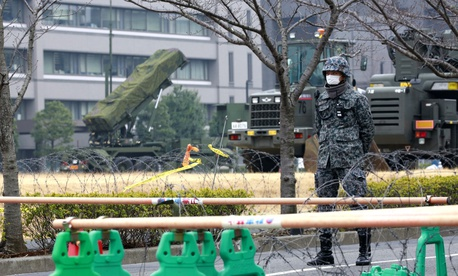 In this March 6, 2017, file photo, a member of the Japan Self-Defense Forces stands by a PAC-3 Patriot missile unit deployed against the North Korea's missile firing, at Defense Ministry in Tokyo.