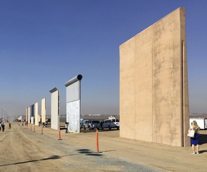 People look at prototypes of a border wall Thursday, Oct. 26, 2017, in San Diego.