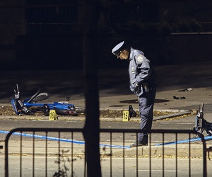 A police officer stands guard next to bicycles on a bike path at the crime scene after a motorist Tuesday drove onto the path, striking and killing several people, in Manhattan, Nov. 1.