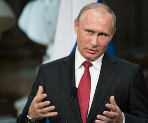 Putin speaks in May in Paris.