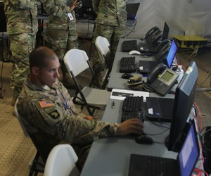 Members of various battle staff elements work to visualize their warfighting functions as part of a User Defined Operational Picture during Cyber Quest 2016 at Fort Gordon, Ga., July 20, 2016.