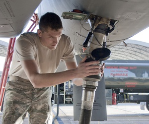 Senior Airman Jacob Prine checks the fuel connection to a F-15 Eagle in 2010.