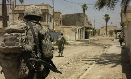 U.S. Army soldiers move toward their next watch location in Baqubah, Iraq in 2007.