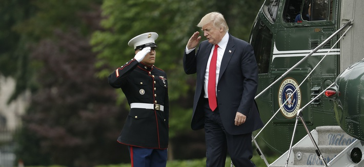 In this June 2017 photo, President Donald Trump is saluted by a Marine as he steps off the presidential helicopter at the White House.