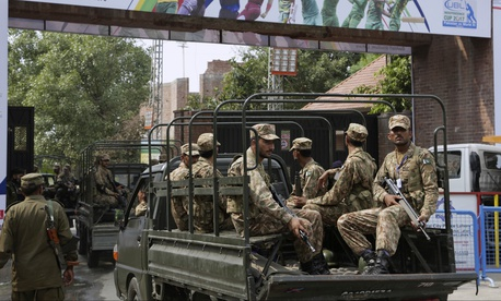 Pakistan army soldiers patrol near Gaddafi Stadium to ensure security ahead of the start of first Twenty20 cricket match between the World XI team and Pakistan, in Lahore, Pakistan, Tuesday, Sept. 12, 2017.