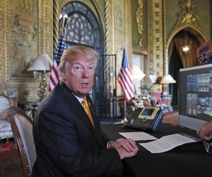 President Donald Trump speaks to the media at his private club, Mar-a-Lago, on Thanksgiving,, Nov. 23, 2017, in Palm Beach, Fla.