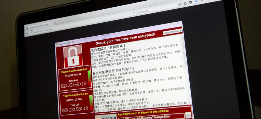 A screenshot of the warning screen from a purported ransomware attack, as captured by a computer user in Taiwan, is seen on a laptop in Beijing, May 13, 2017.