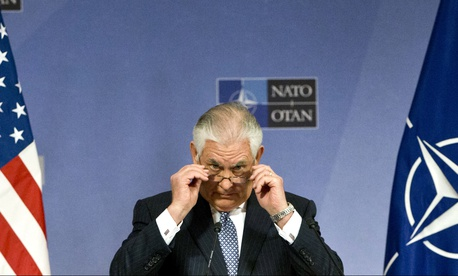 U.S. Secretary of State Rex Tillerson adjusts his glasses as he speaks during a media conference at NATO headquarters in Brussels on Wednesday, Dec. 6, 2017.