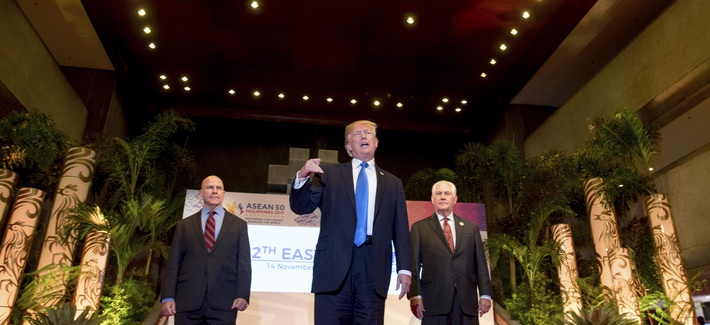 President Donald Trump, accompanied by Secretary of State Rex Tillerson, right, and National Security Adviser H.R. McMaster, speaks to the media at the Philippine International Convention Center, Nov. 14, 2017, in Manila.