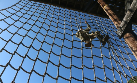 A U.S. Army officer climbs the cargo net obstacle at the 3rd Annual Thornsbury Challenge during Marne Week, Nov. 15, 2017 at Fort Stewart, Ga.