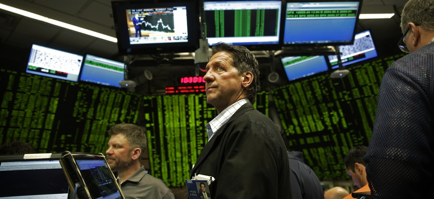 Traders work in a trading pit at the Chicago Board Options Exchange, Monday, Dec. 11, 2017, in Chicago, as they trade S&P 500 Options, unrelated to bitcoin futures. Trading in Bitcoin futures began Sunday on the CBOE.