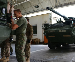 NATO allied soldiers, pictured here, refuel U.S. Stryker vehicles. The reverse proved difficult at a recent multinational exercise in Poland.