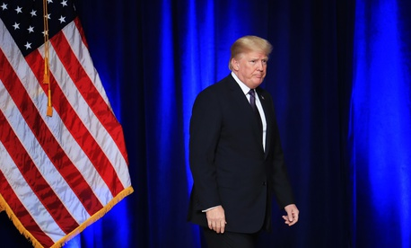 President Donald Trump leaves the stage after laying out a national security strategy in Washington, Dec. 18, 2017.