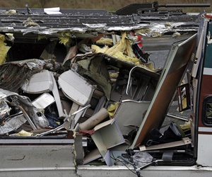 Seats are jammed together with other debris on an upside-down Amtrak train car sitting on a flat bed trailer taken from the scene of Monday's deadly crash onto Interstate 5.