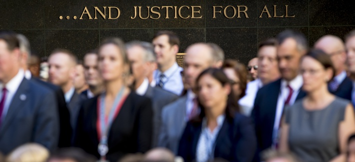 FBI employees listen as Attorney General Jeff Sessions speaks at an installation ceremony for FBI Director Chris Wray at the FBI Building earlier this fall.
