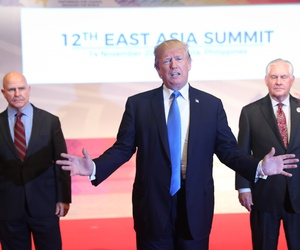 Lt. Gen. H.R. McMaster, left, and Secretary of State Rex Tillerson, right, with President Donald Trump at the East Asia Summit, Nov. 14, 2017, in Manila, Philippines.
