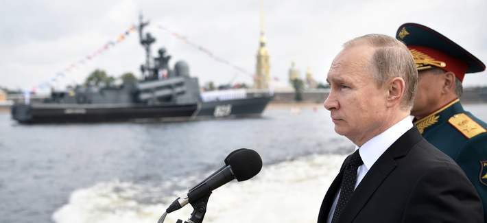 Russian President Vladimir Putin rides on a boat attending a naval parade during the Navy Day celebration this summer.