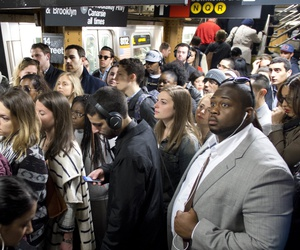 In this May 16, 2016 photo, commuters crowd a platform after exiting the L train in the Union Square subway station in New York.