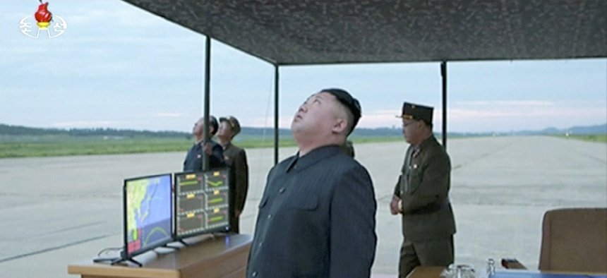 North Korea's Kim Jong Un looks up at the sky at what is said to have been a missile launch on Aug. 29, 2017, at an undisclosed location in North Korea.