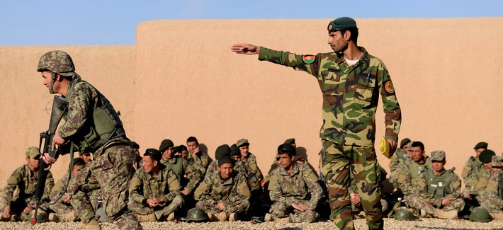 An Afghan National Army noncomissioned officer instructs his soldier to move during a clearance training drill at the Regional Military Training Center in Helmand Province, Afghanistan, March 8, 2017.