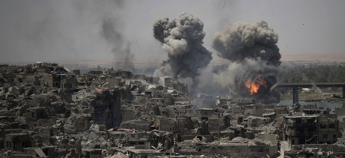 "Airstrikes target Islamic State positions on the edge of the Old City a day after Iraq's prime minister declared ""total victory"" in Mosul, Iraq, July 11, 2017."