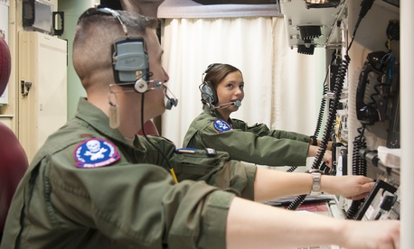 First Lt. Pamela Blanco-Coca and 2nd Lt. John Anderson, simulate key turns of the Minuteman III ICBM in a Launch Control Center on the F.E. Warren Air Force Base Missile Complex in Wyoming.