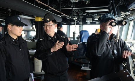 U.S. and Republic of Korea Navy officers inside the guided-missile destroyer USS McCampbell (DDG 85), in waters west of the Korean Peninsula, March 16, 2013.