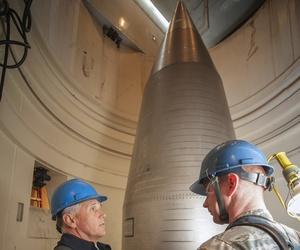 From left, Vice President Mike Pence speaks with Capt. Kevin O'Neill, 91st Missile Maintenance Squadron maintenance operations officer, beside a LGM-30 Minuteman III intercontinental ballistic missile near Lansford, N.D., Oct. 27, 2017.