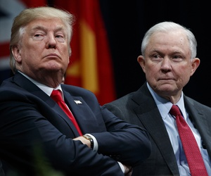 President Donald Trump, left, sits with Attorney General Jeff Sessions during the FBI National Academy graduation ceremony in Quantico, Va., Dec. 15, 2017.