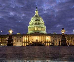 Lights shine inside the U.S. Capitol Building as night falls in Washington, Sunday, Jan. 21.