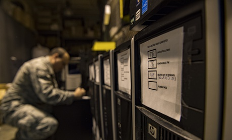 A U.S. Airman reassembles computers at McLaughlin Air National Guard Base, Charleston, W.Va., Nov. 28, 2017.