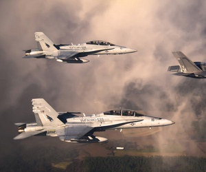 A U.S. Marine Corps F-35 Lightning II aircraft is escorted by two Marine F/A-18 Hornets.