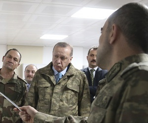 urkey's President Recep Tayyip Erdogan, second left, is briefed by a Turkish Army officer at the command center at the command center in Hatay province, Turkey at the border with Syria, Thursday, Jan. 25, 2018.