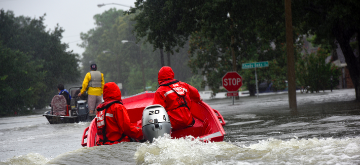 Coast Guard petty officers pilot a 16-foot flood punt boat and join good Samaritans in patrolling a flooded neighborhood in Friendswood, Texas after Hurricane Harvey.