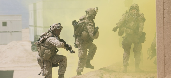 Marines with 2nd Battalion, 7th Marine Regiment, enter a building during an urban assault at Range 200 aboard Marine Corps Air Ground Combat Center, Twentynine Palms, California, May 16, 2017