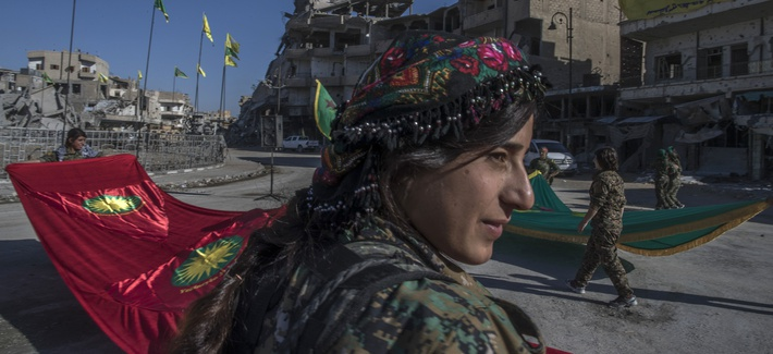 Women of the YPJ celebrate their defeat of ISIS in Raqqa, Syria, Thurs., Oct. 19, 2017.