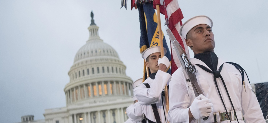 The U.S. Navy Ceremonial Guard parades the colors during the National Memorial Day concert on the west lawn of the U.S. Capitol in Washington, D.C., May 28, 2017.