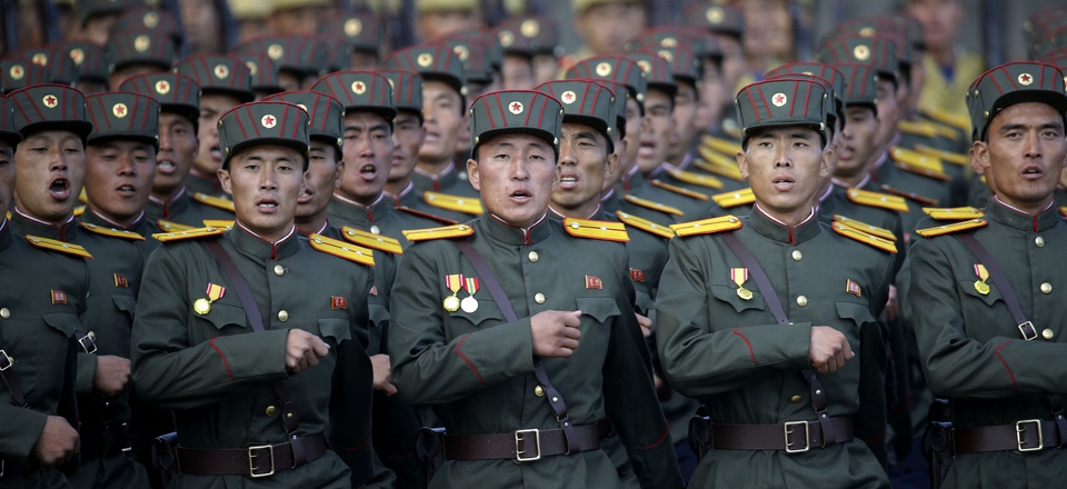 North Korean soldiers, wearing historical uniforms, parade in Pyongyang, North Korea, on Oct. 10, 2015.